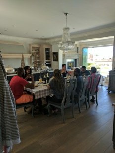 Us eating breakfast. If you look closely you can see the glass windows that are open up to a small pond
